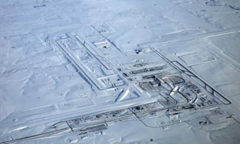Aerial view of an airport covered in snow.