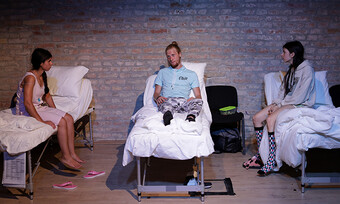 actors onstage in hospital beds