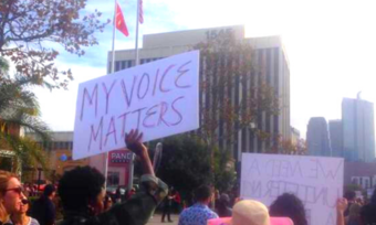 "a person holding a sign that says ""my voice matters"""
