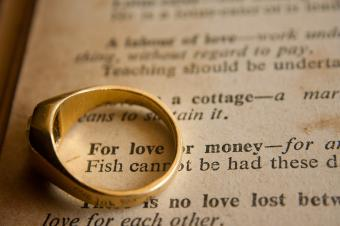 book with quote saying for love or money, with a ring sitting on the page