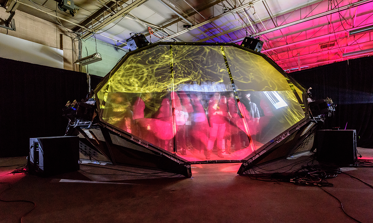 audience members inside an enclosed transparent VR tent