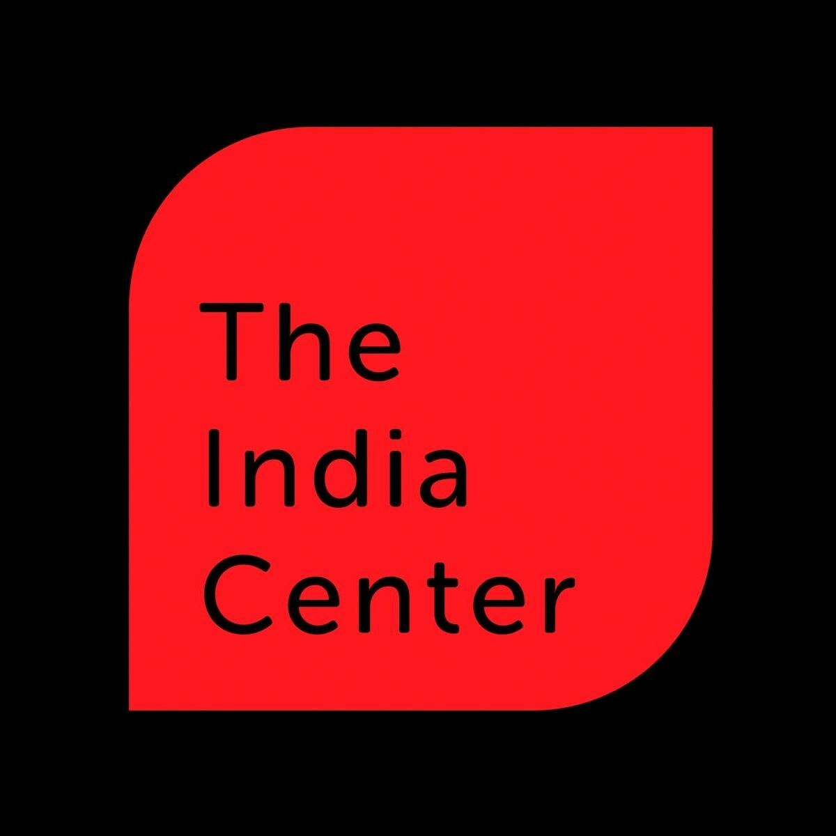 red shape with black text india center