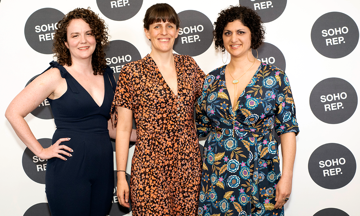 three people posing for a photo at a soho rep event