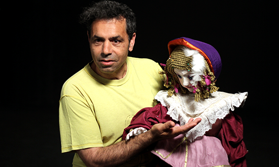 A man with puppet.