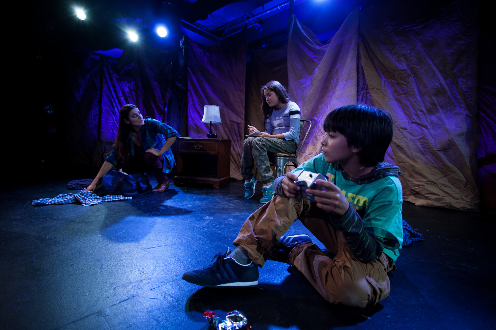 a boy sits on stage